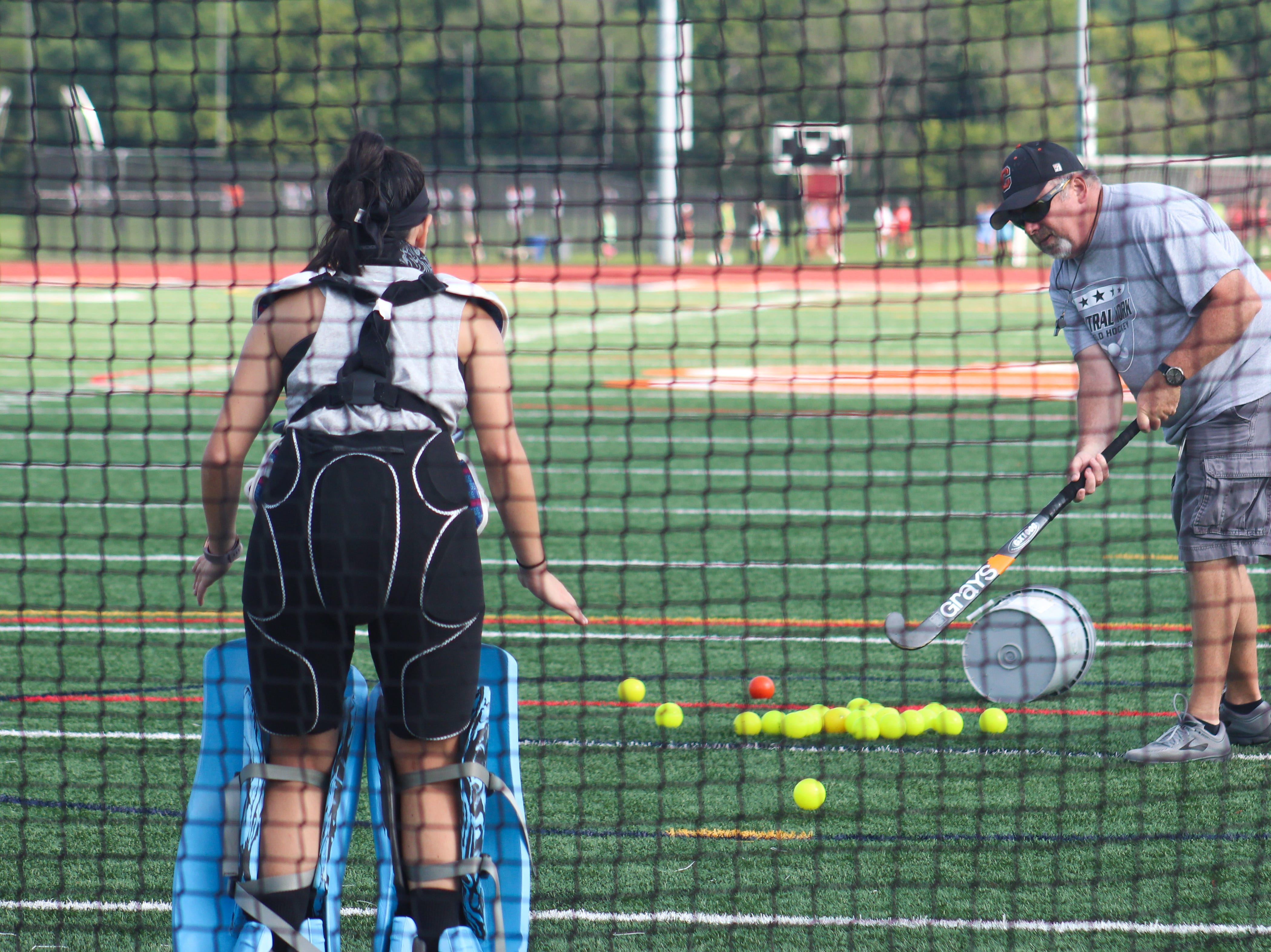A Central York field hockey goalie practices making saves on August 13, 2018.