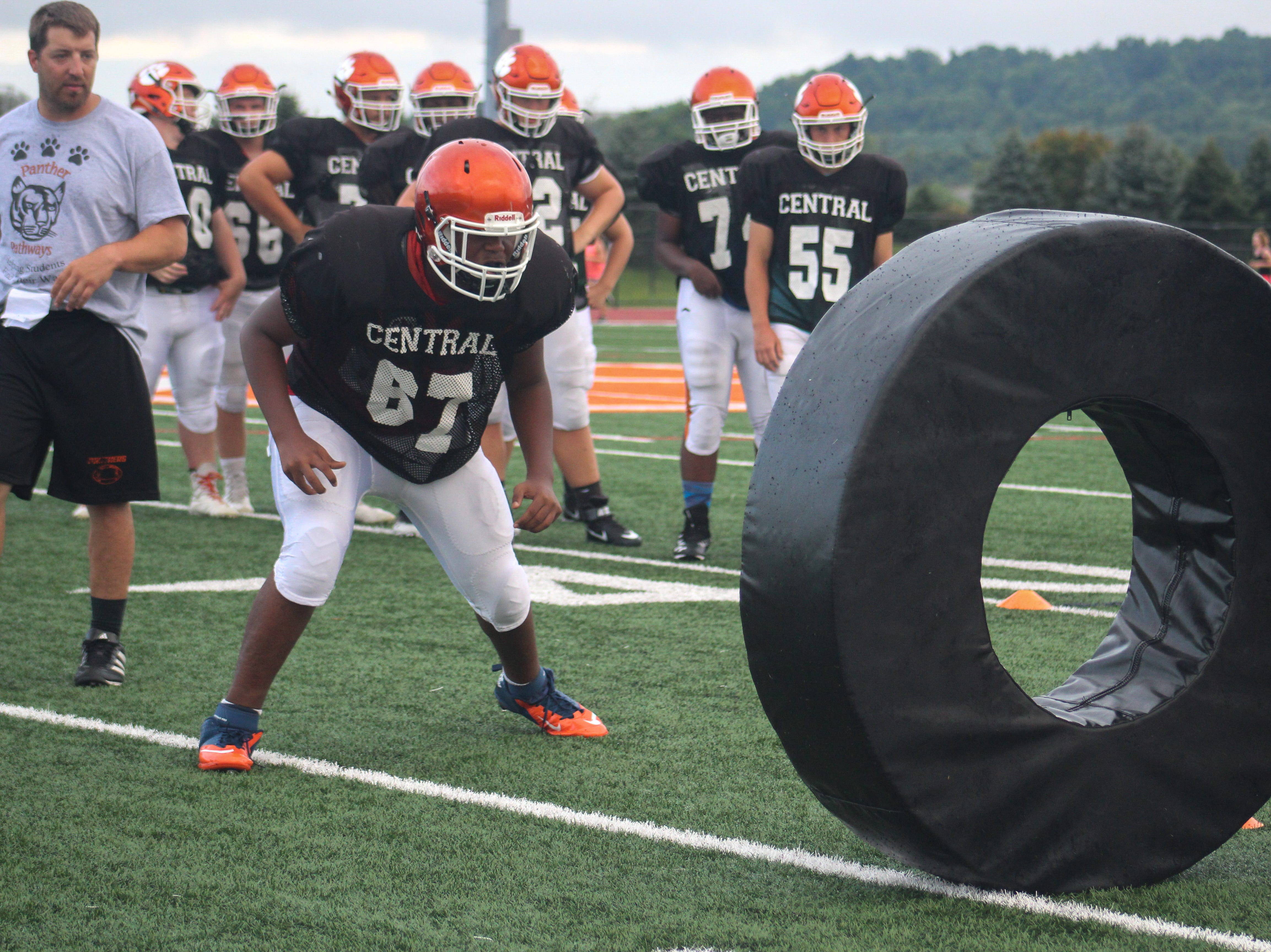 A Central York High School lineman faces a tackling dummy during the first day of fall practice.