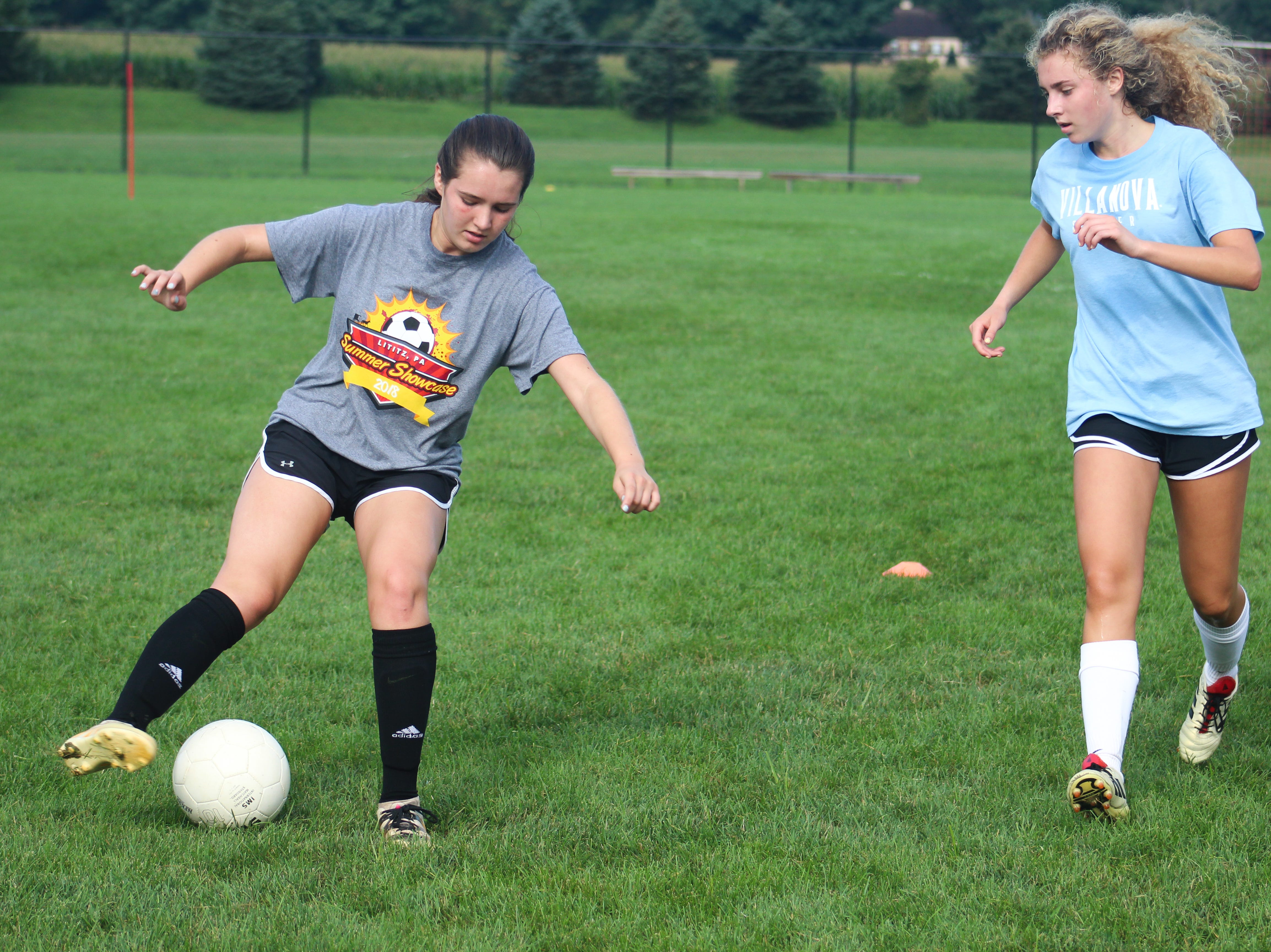 Central York High School girls' soccer players run through a drill on August 13, 2018.