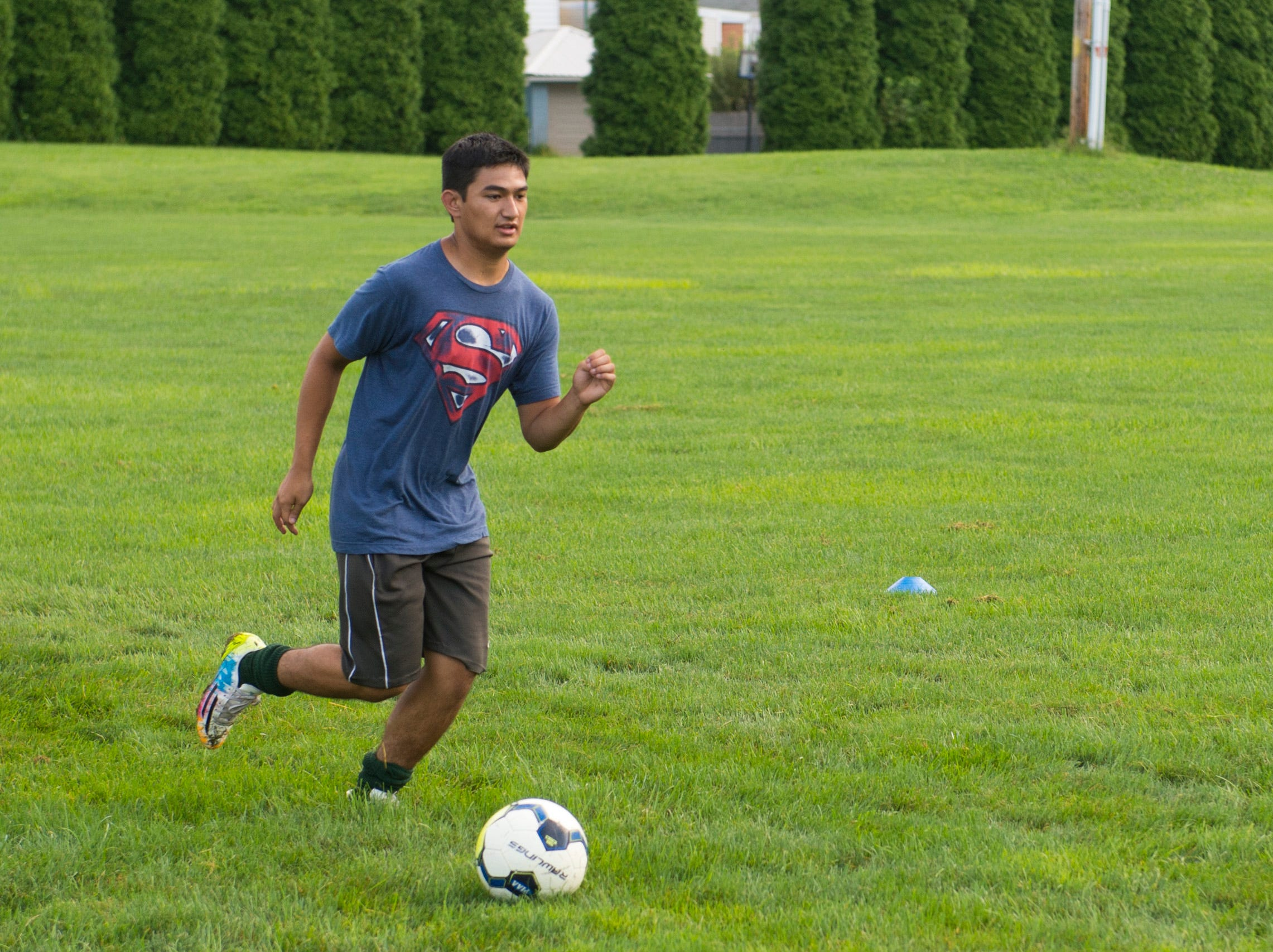 A York Catholic soccer player begins a drill on the first day of fall practice.