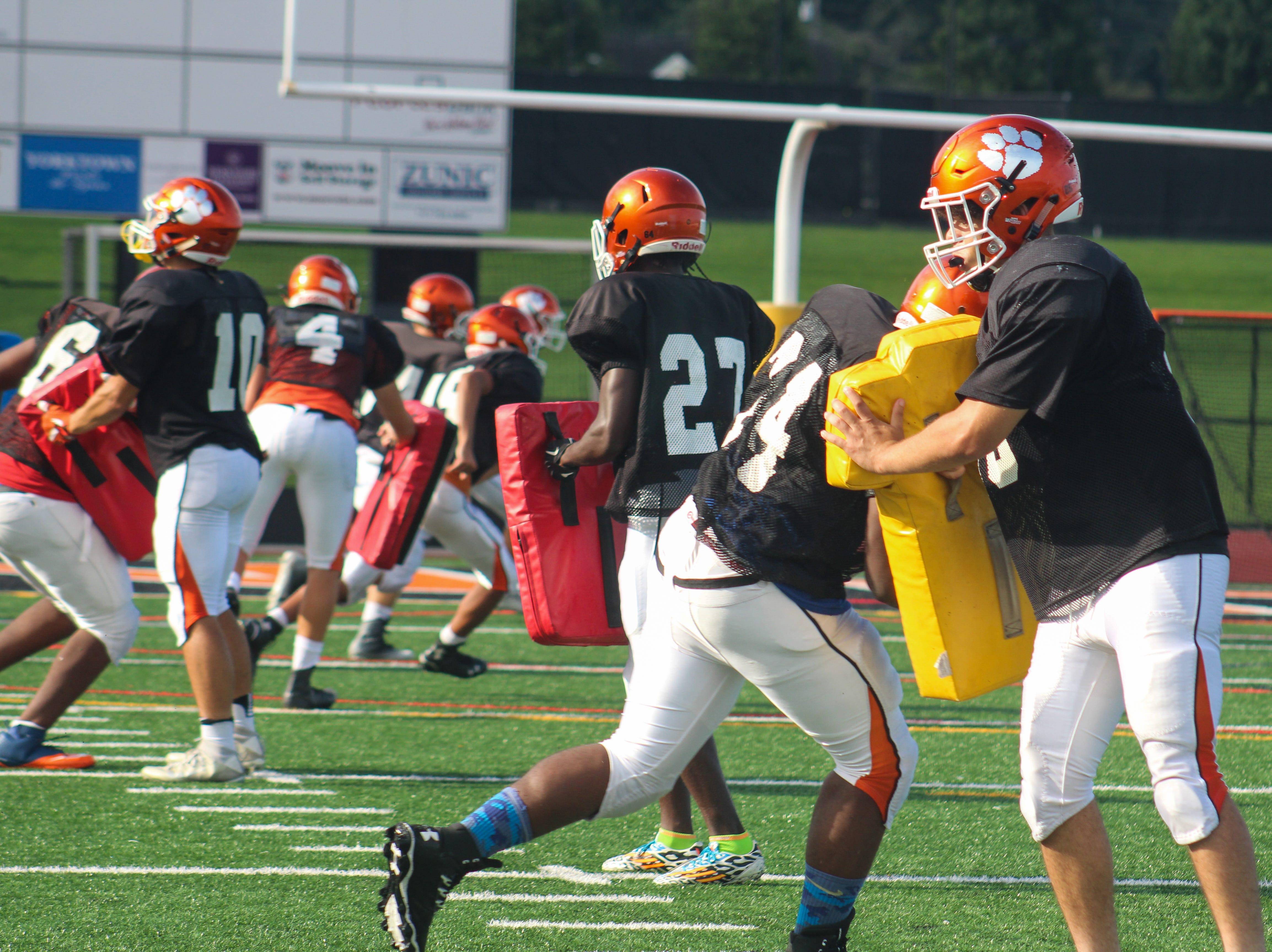 Central York High School football players run through a drill on August 13, 2018.