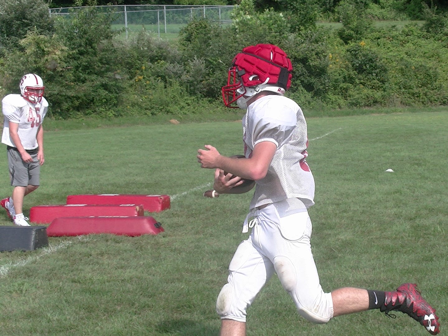 A Susquehannock football players runs with the ball during the first day of fall practice on Monday.