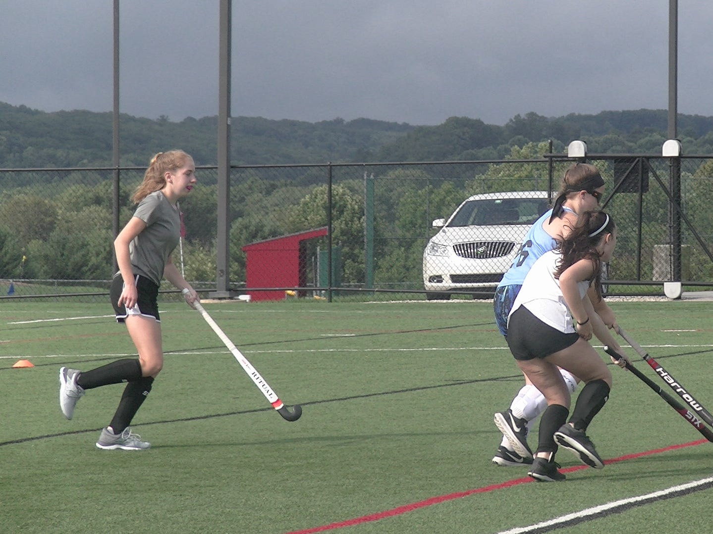 Susquehannock field hockey players battle for the ball during the first day of fall practice on Monday.