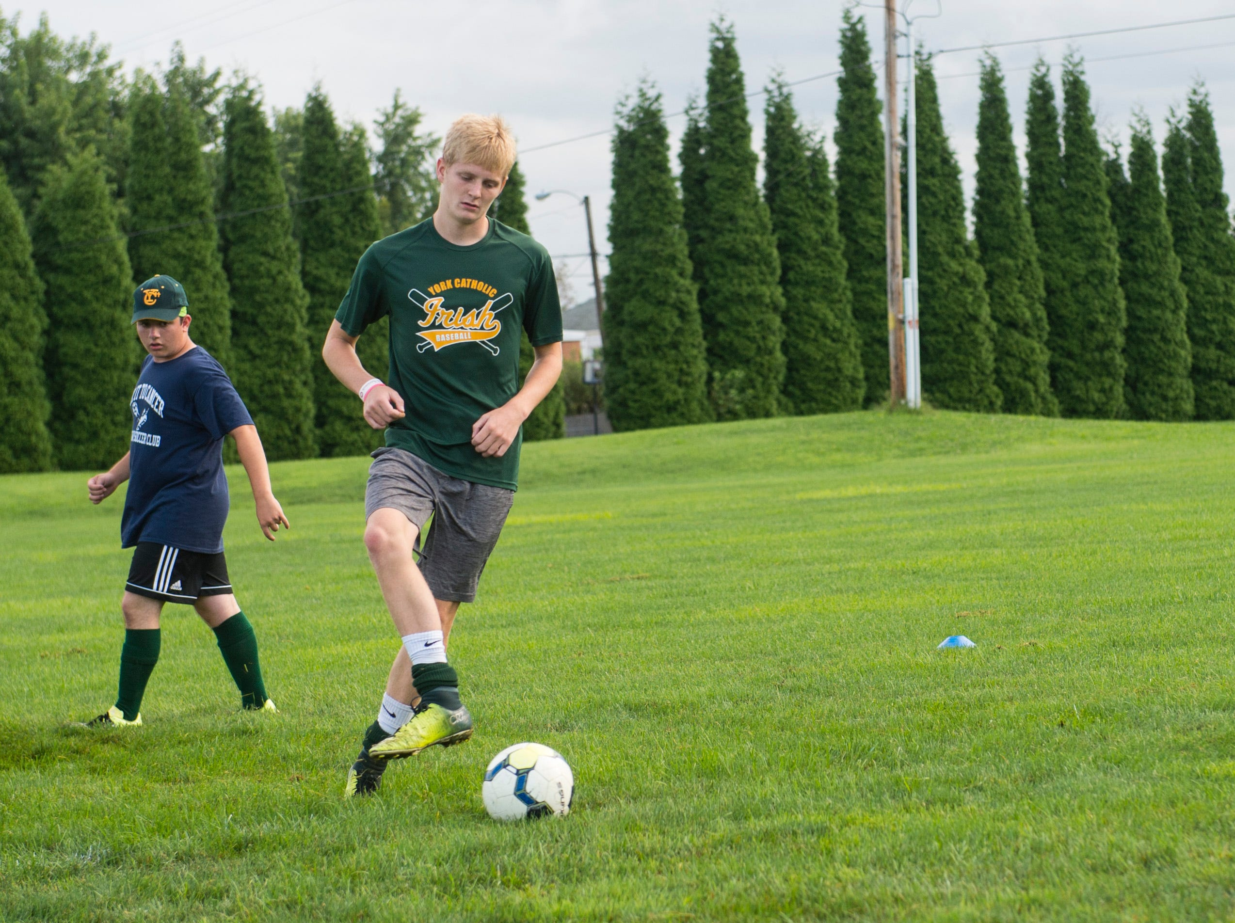 The York Catholic boys' soccer team spent the beginning part of practice in one and two-touch passing drills.