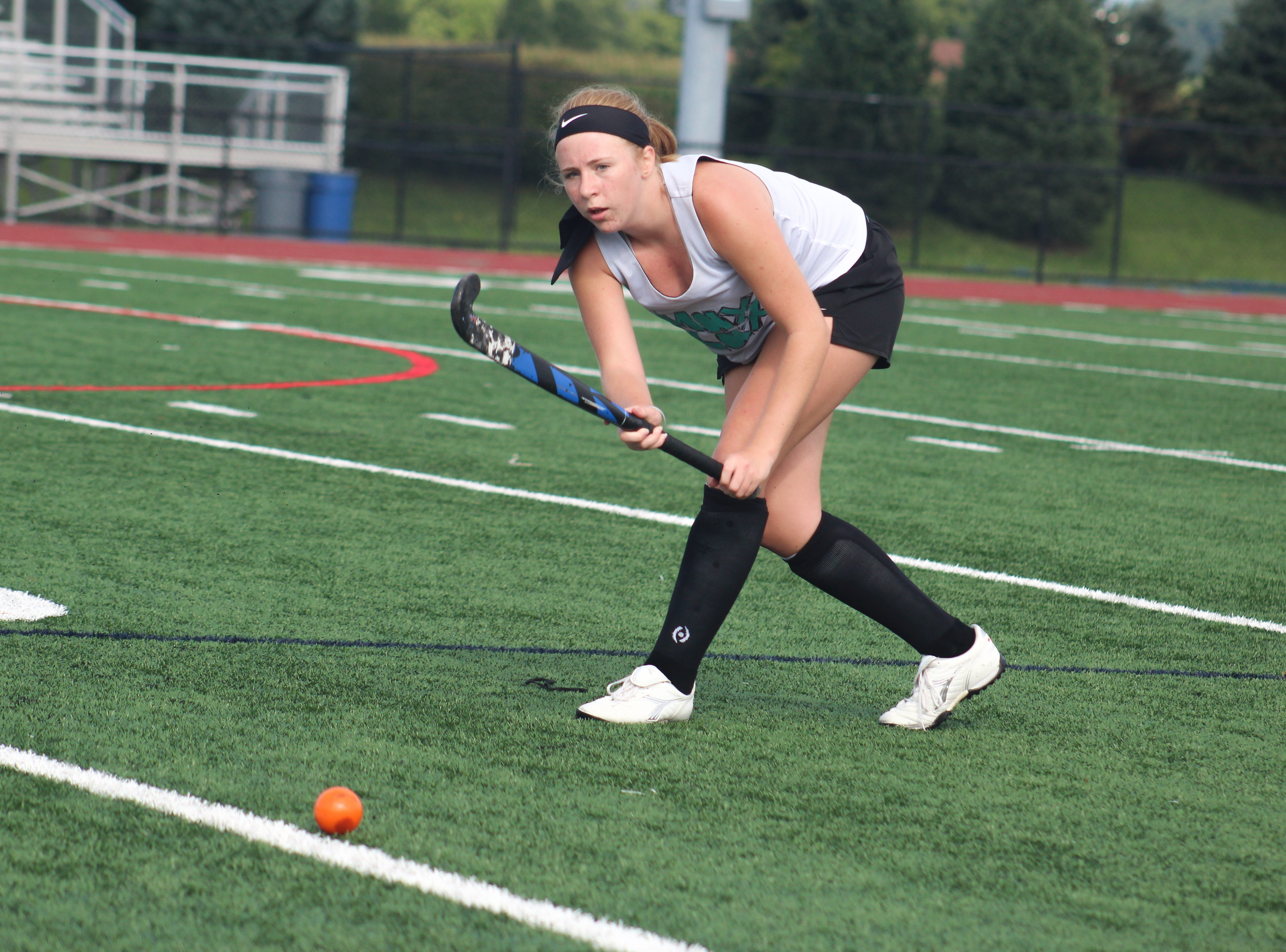 A Central York High School field hockey player runs through a drill during the first day of fall practice.