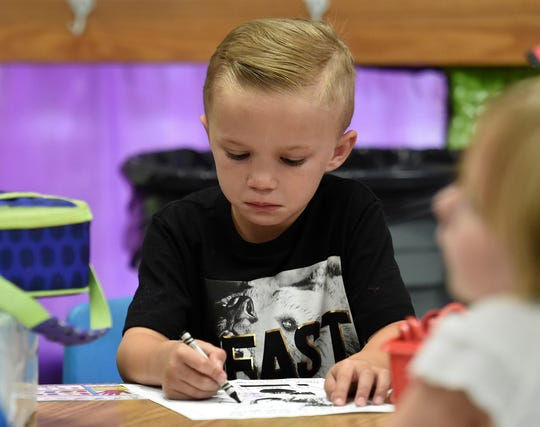 Brock Evans, 5, who started kindergarten Monday holds back tears at Hidden Valley Elementary School. He joins the class of 2031.