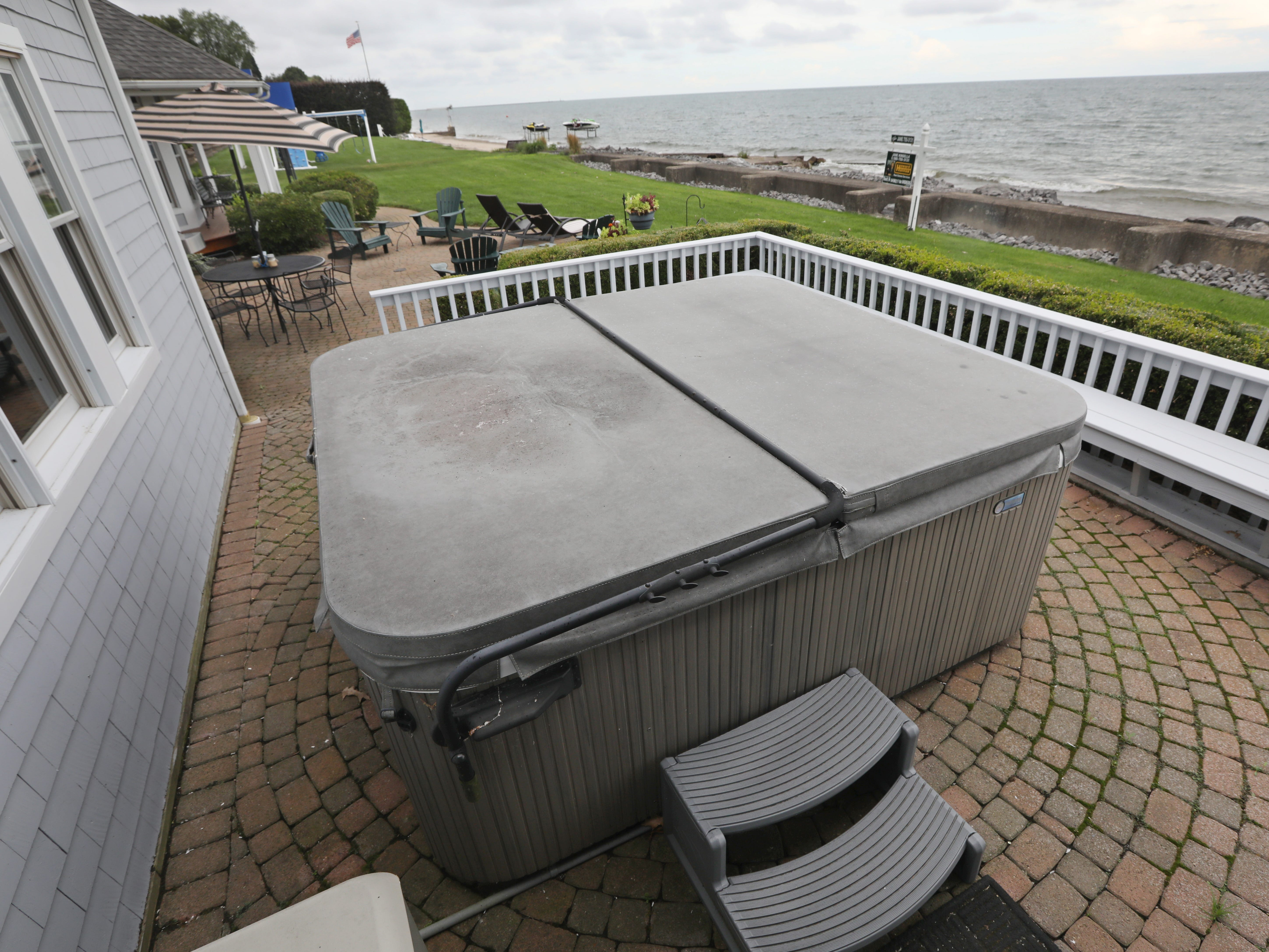 A hot tub is found on the back patio, with views of Lake Ontario.