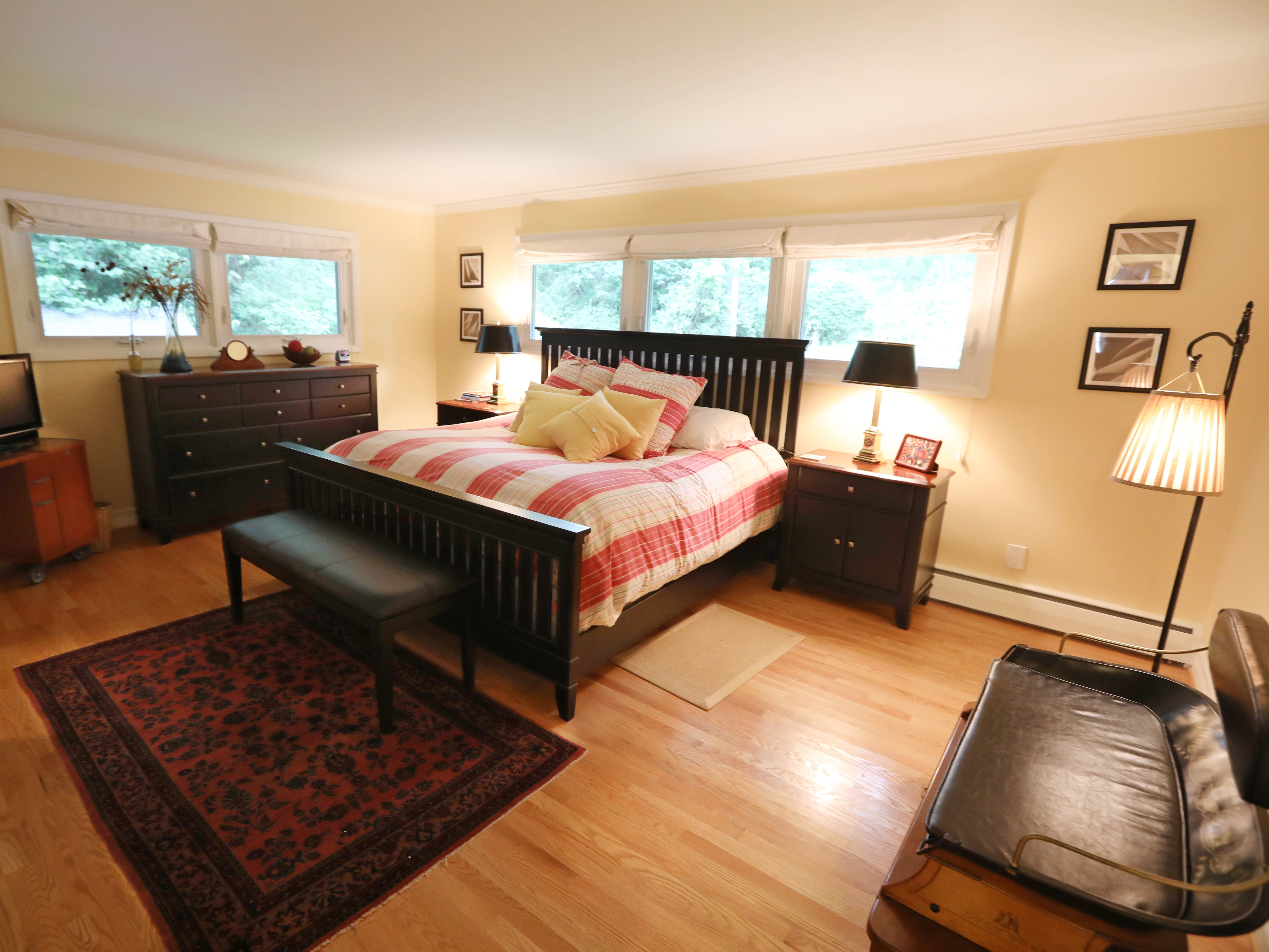 The master bedroom on the first floor at 1060 Rock Beach Road.  The home features five bedrooms.