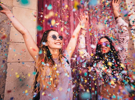 Young Multi Ethnic Hipster Women Celebrating With Confetti In The City