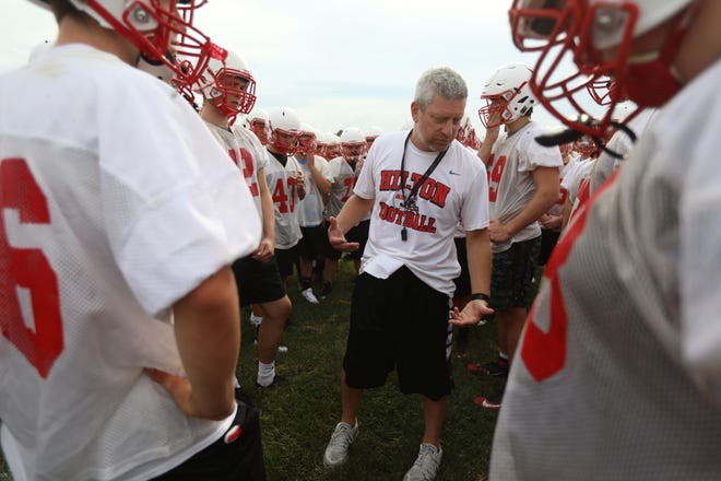 Hilton High School football coach, Rich Lipani, goes over practice expectations during the first day of official practice.