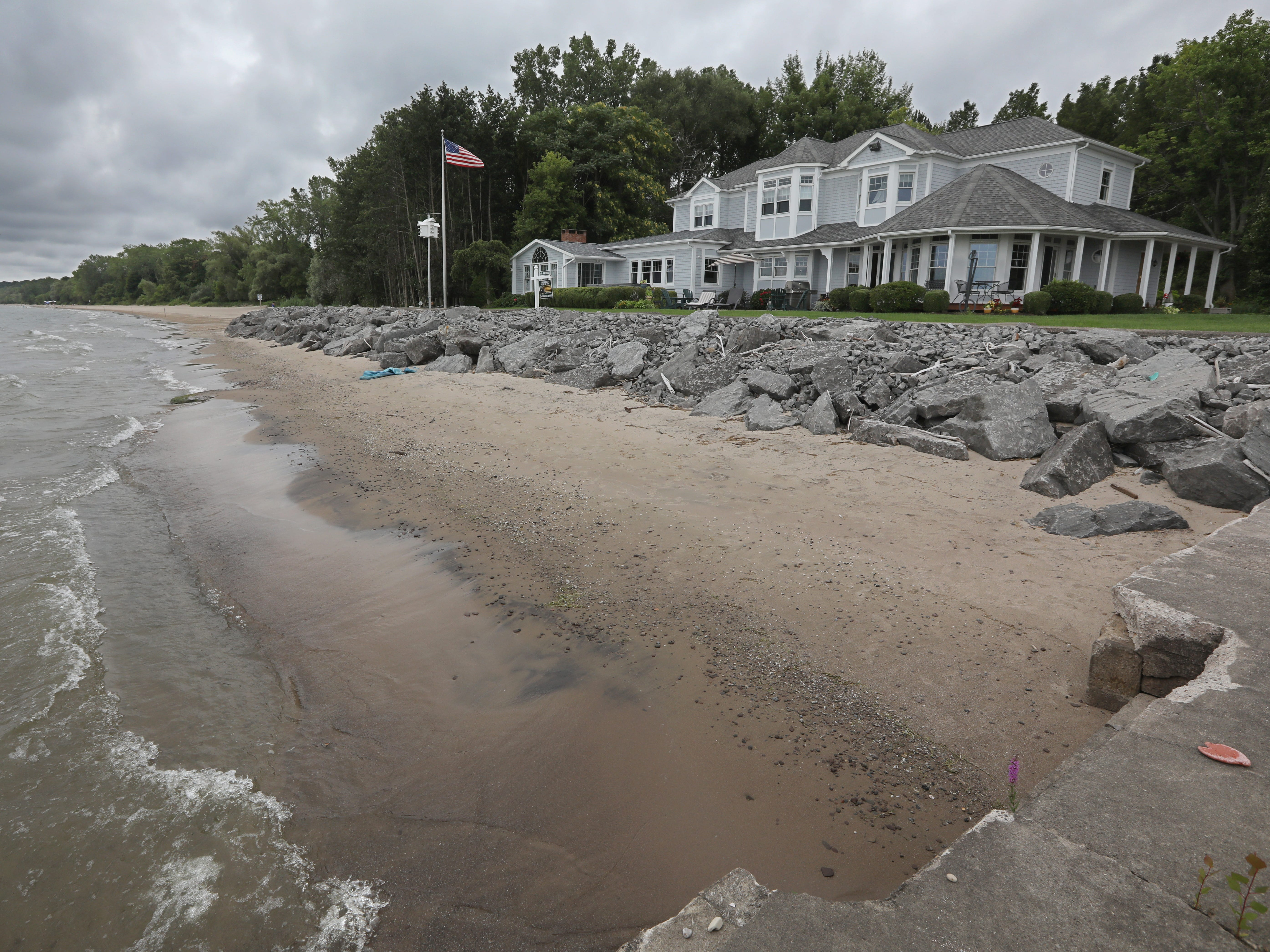 """With its own sandy beach along Lake Ontario, the home at 1060 Rock Beach Road, known as the """"Gold Coast"""" in Irondequoit, is now on the market for $795,000."""