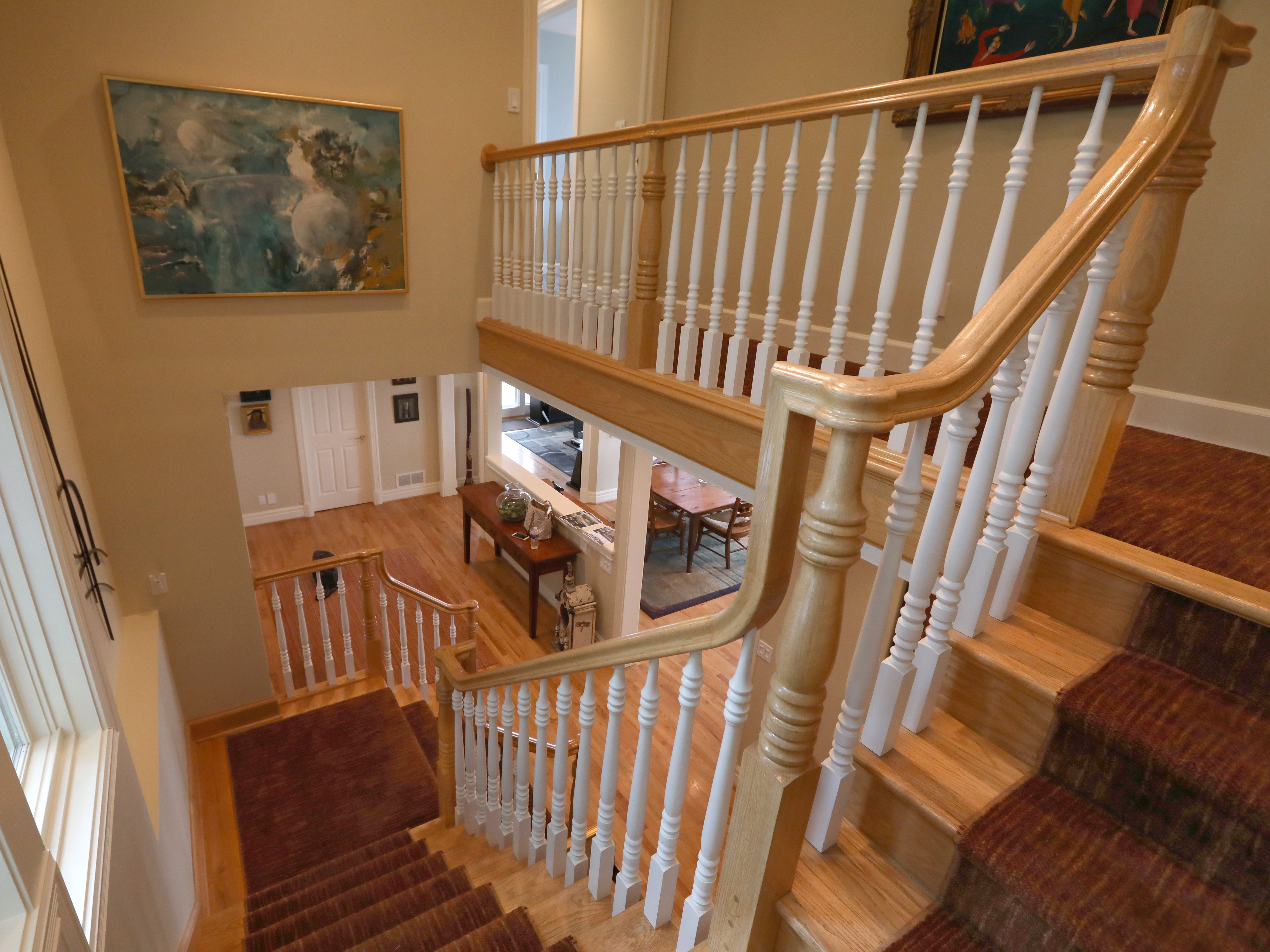 The carpeted stairs leading to the second floor.