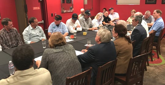 Agriculture Secretary Sonny Perdue, third from left, and Interior Secretary Ryan Zinke meet representatives from the city of Redding and Shasta County, along with legislators Monday during a roundtable discussion of the Carr Fire and related issues at Karline's Restaurant in Redding.