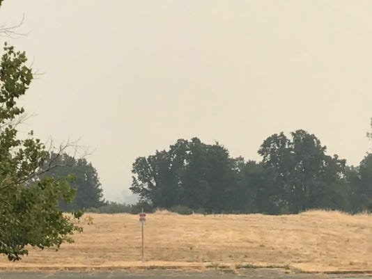 Smoke in Redding obscures Mt. Shasta and surrounding foothills.