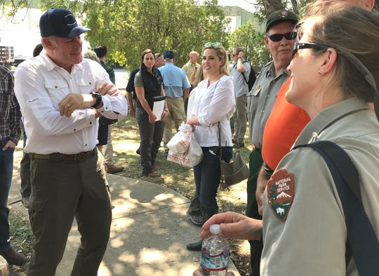 Interior Secretary Ryan Zinke, left, meets with staff members from Whiskeytown National Recreation Area on Monday during a tour of the Redding smokejumpers' base.