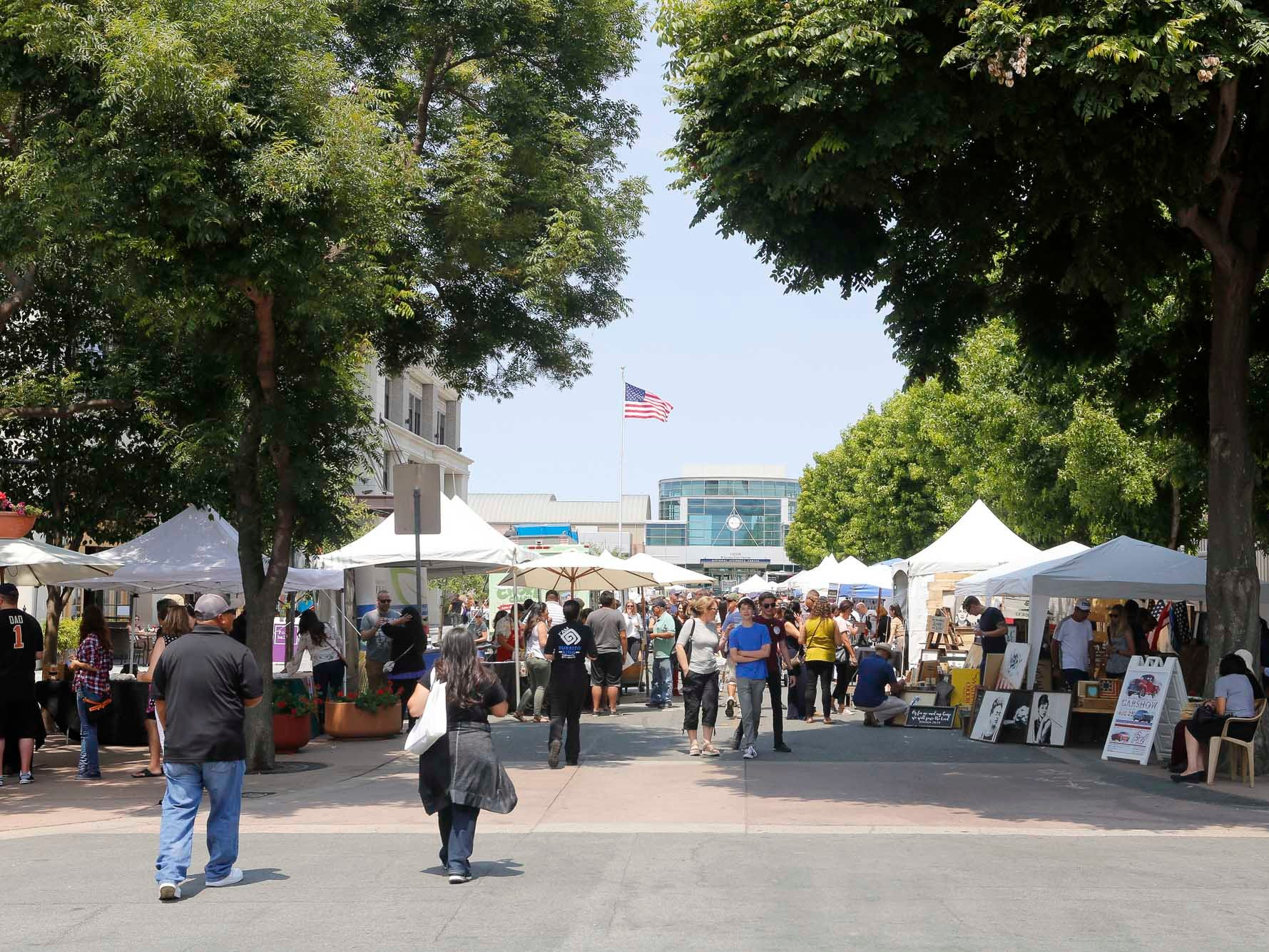 Attendees come and go as they sample food and wine during the 2018 Salinas Valley Food and Wine Festival which takes place on Main Street in Old Town Salinas on Saturday, August 11, 2018.