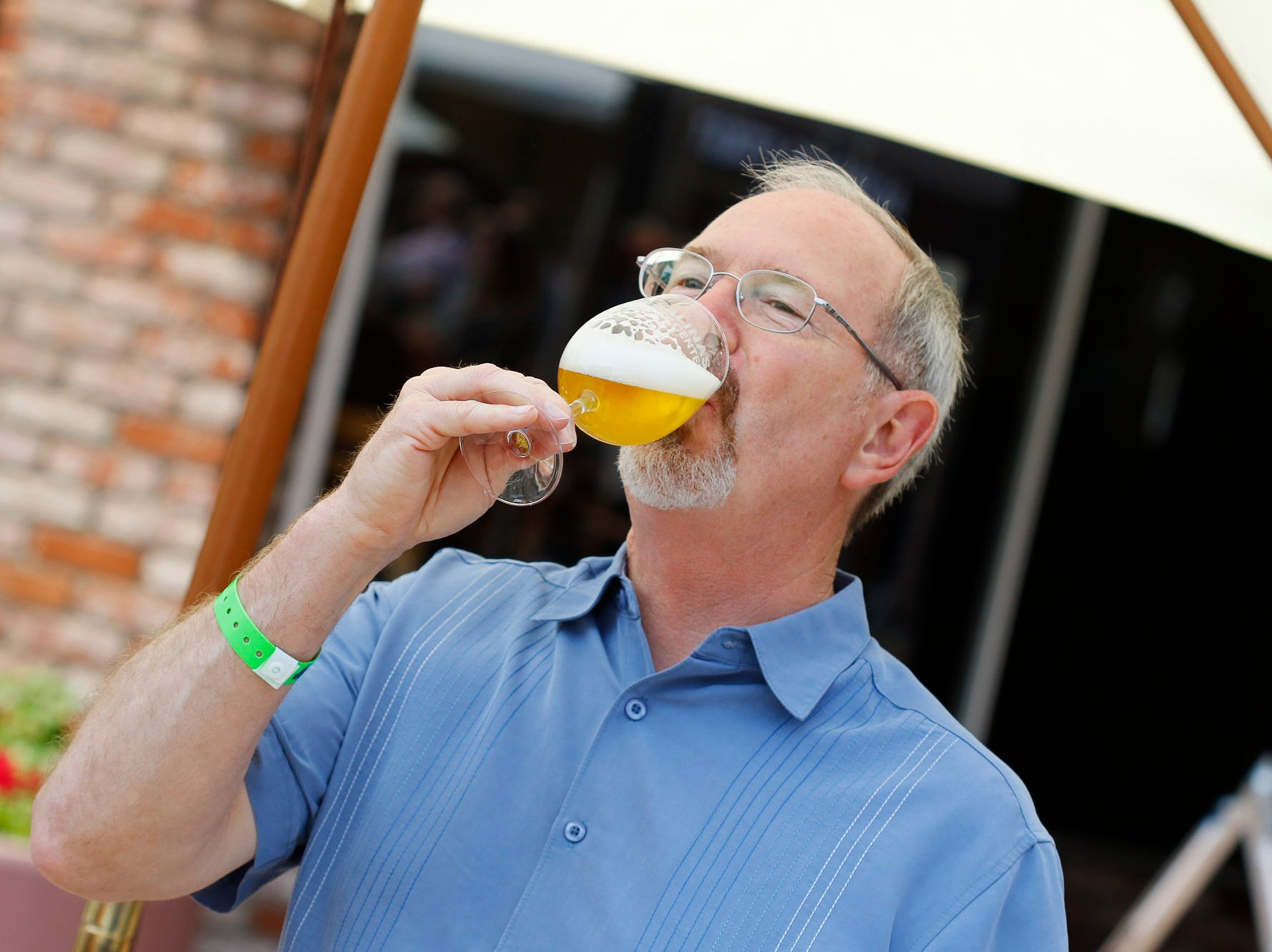 A man samples a beer during the 2018 Salinas Valley Food and Wine Festival which takes place on Main Street in Old Town Salinas on Saturday, August 11, 2018.