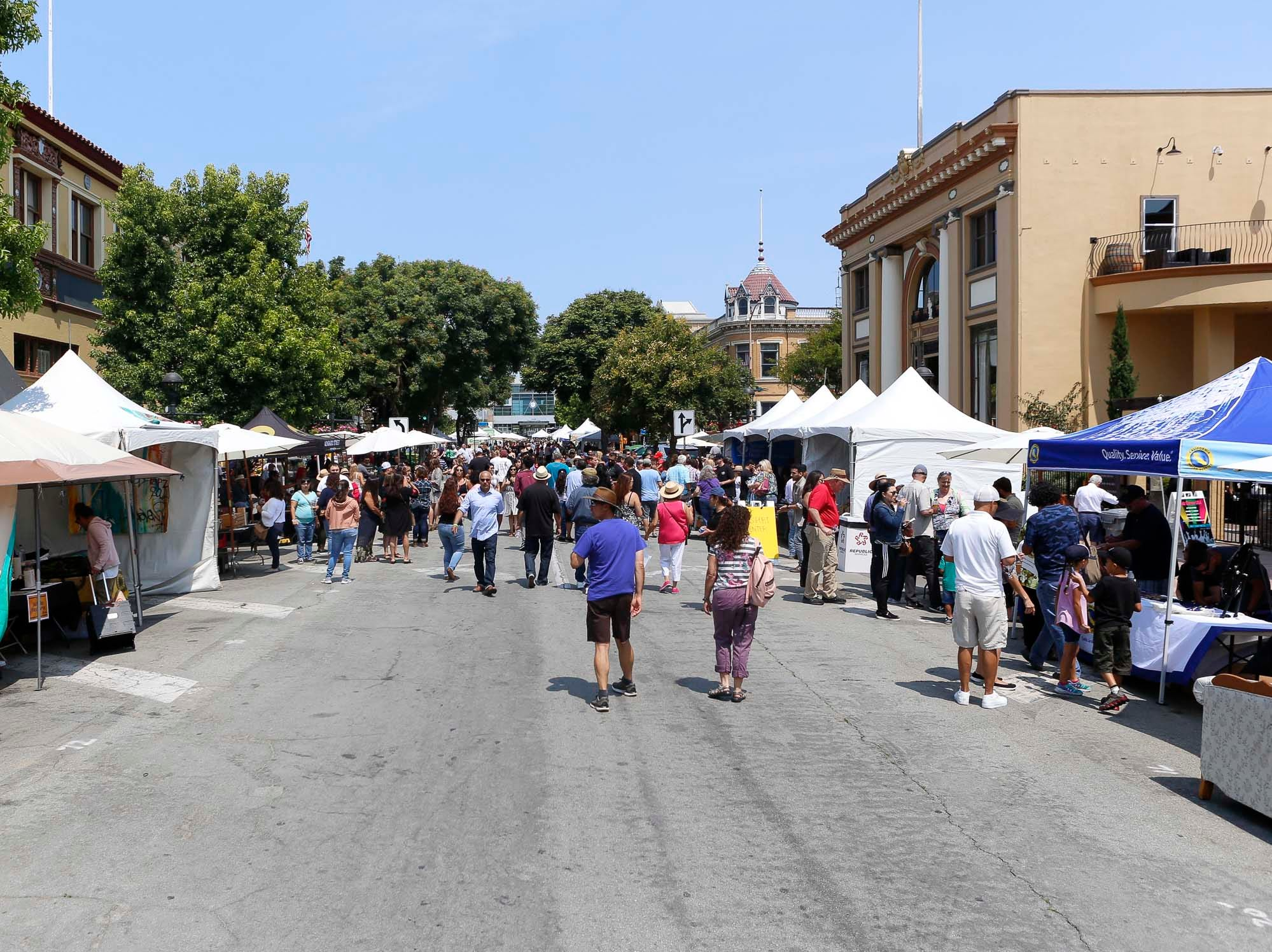 Attendees walk during the 2018 Salinas Valley Food and Wine Festival which takes place on Main Street in Old Town Salinas on Saturday, August 11, 2018.