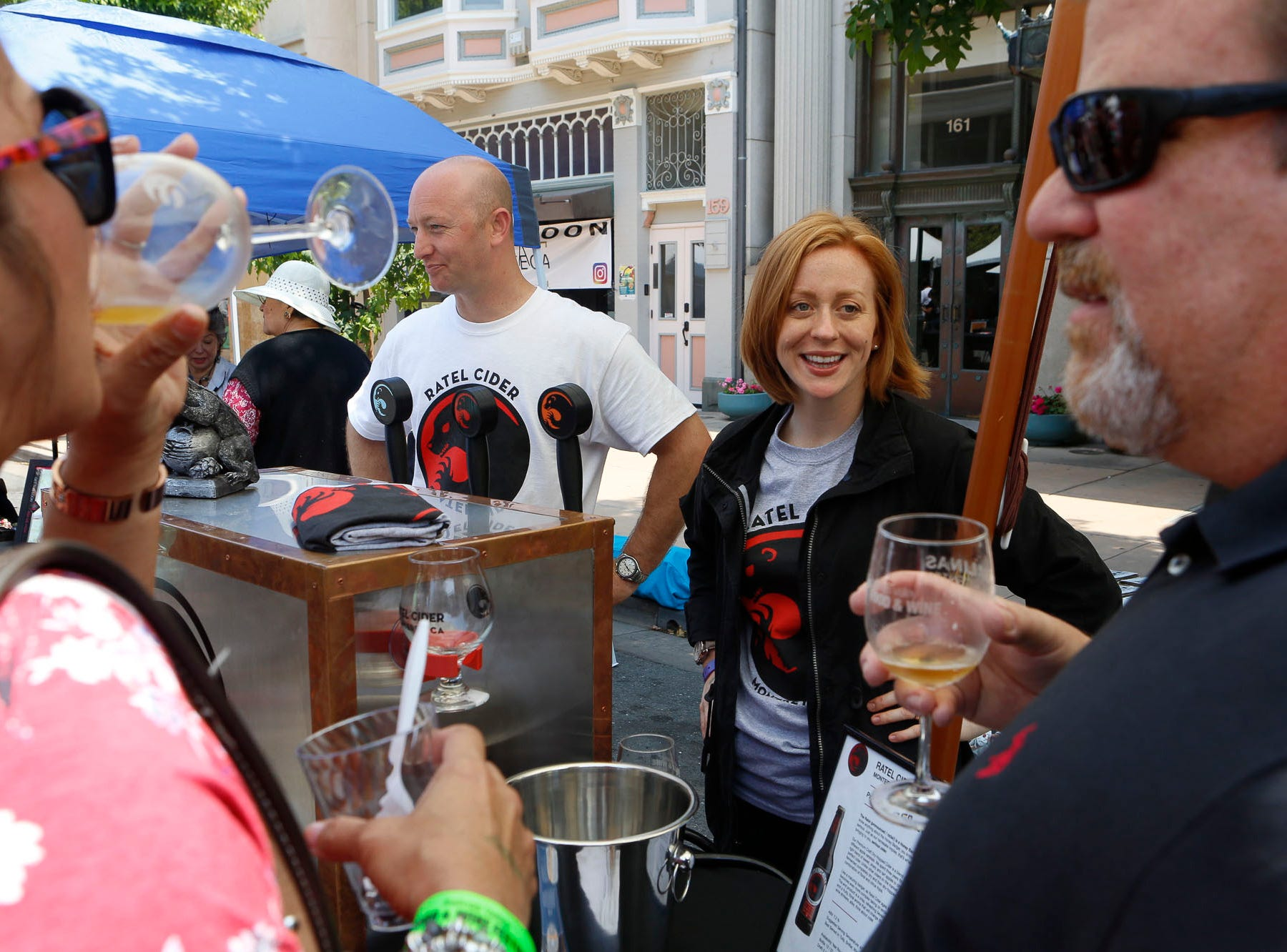 Vintners chat with attendees sampling wine during the 2018 Salinas Valley Food and Wine Festival which takes place on Main Street in Old Town Salinas on Saturday, August 11, 2018.
