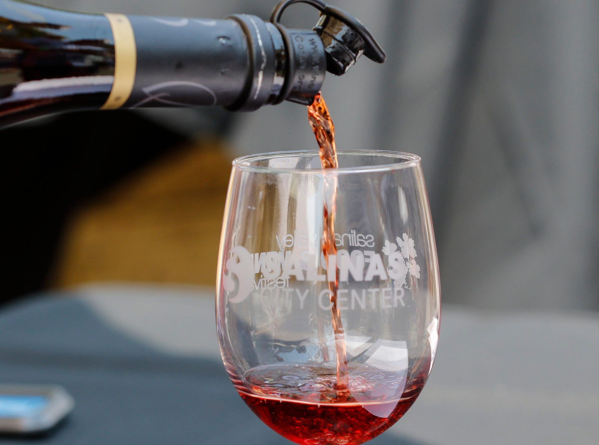 Vintners sample their wine during the 2018 Salinas Valley Food and Wine Festival which takes place on Main Street in Old Town Salinas on Saturday, August 11, 2018.