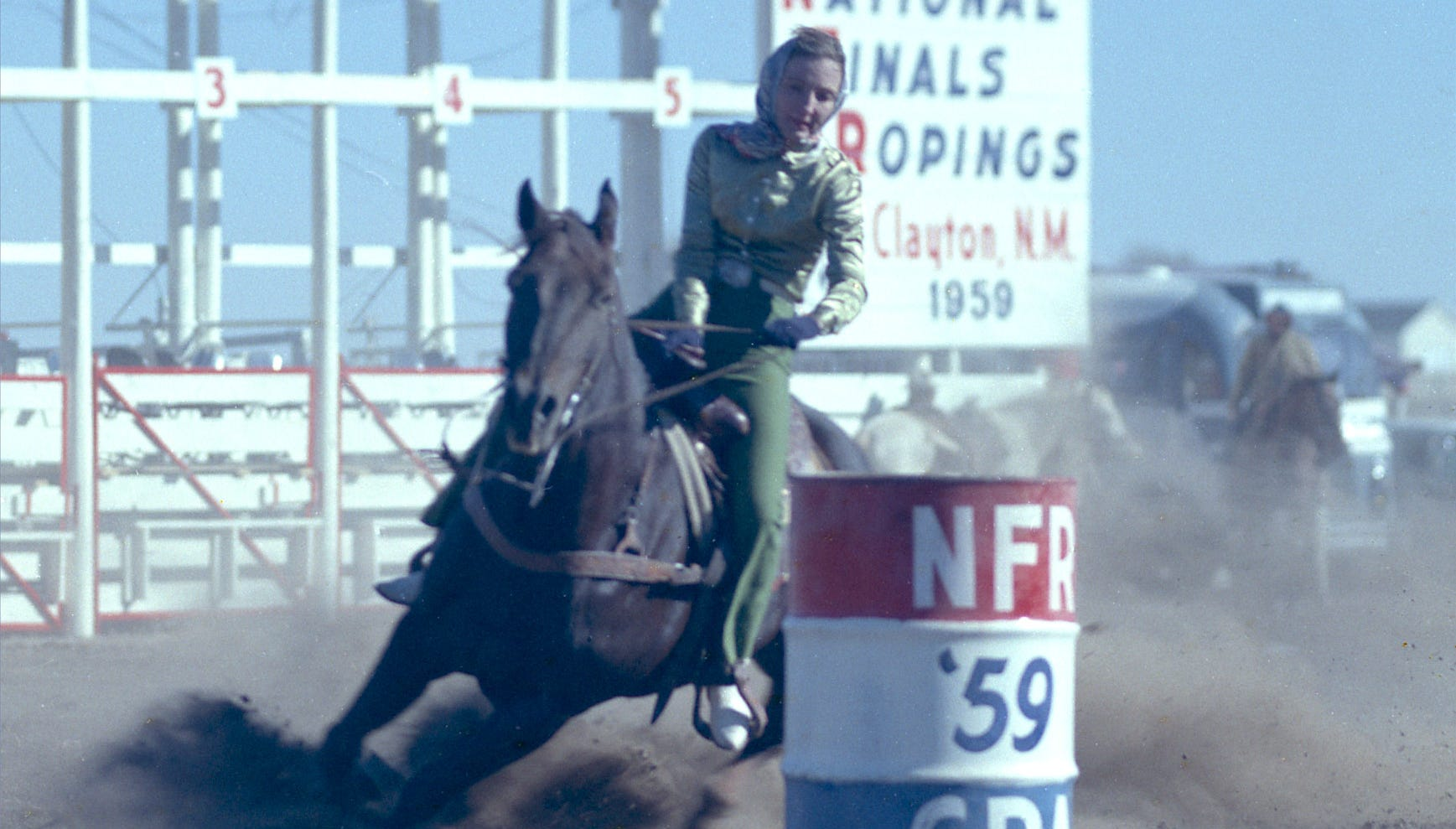 Billie McBride and her horse, Zombie, compete at the 1959 national finals in Clayton, New Mexico.
