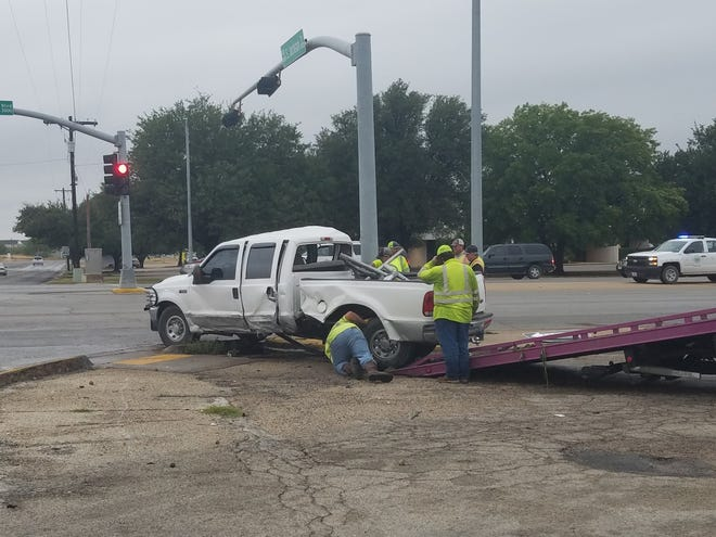 A Ford F250 wraps around a utility pole after a collision on South Bryant and Jackson St.