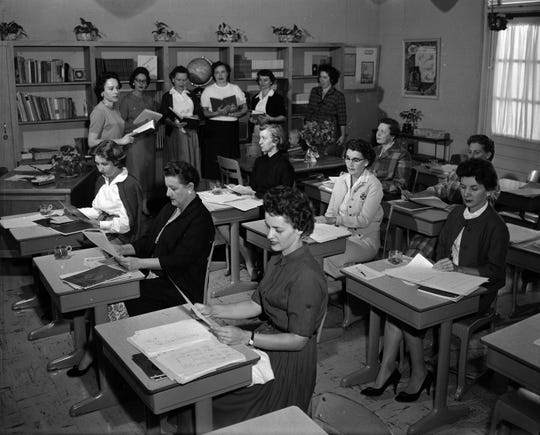 Teachers preparing to return to school in 1958.