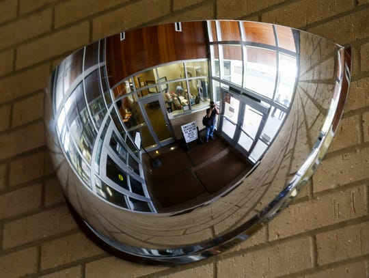 A wide-angle mirror at Jeffries Elementary School gives the main office a total view of the secure vestibule at its entryway.
