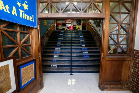 Visitors walk up a steep staircase that leads to the main office after entering Boyd Elementary School.