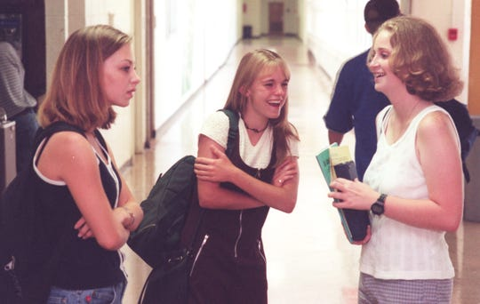 Parkview High School students Jenni Thompson, left, Lacey Grimes, center and Amy Young, renew their friendship the first day of school at Parkview High School.
