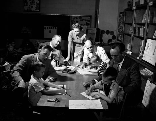 Fathers accompany their first-graders to school in 1954. Pictured from left to right are Billy Dillstrom and his dad, Don; Glen Baker Young and his dad,  James D.; teacher Aline Grace; Harry G. Hoffmann Sr. and junior; and Gary Steward with his dad, A. Ronald.