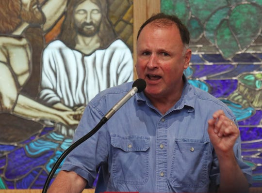 """Virginia state senator of the 25th District, Creigh Deeds, addresses crowd at the Albemarle-Charlottesville NAACP program """"A Time for Reflections and Healing"""" at Zion Union Baptist Church in Charlottesville on Sunday, Aug. 12, 2018."""