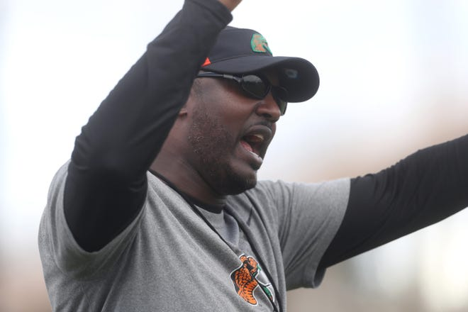 FAMU Head Coach Willie Simmons leads his team during the first day of fall practice on the university's campus Friday, Aug. 3, 2018.