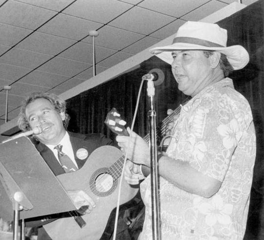 Gov. Bob Graham, right, dressed like Jimmy Buffett and Buffett wore Graham's trademark Florida tie during a performance in 1985 at the annual Florida Press Corps Skits in Tallahassee.