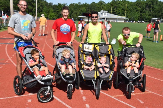 "The ""Baby Daddies"" Stroller Relay Team. Left to right – Zach Deveau and Barret Deveau; Zack Scharlepp and Reis Scharlepp; Eric Godin – Aryana and Chase - Godin; Cory Wilson – Piney Leona Wilson"