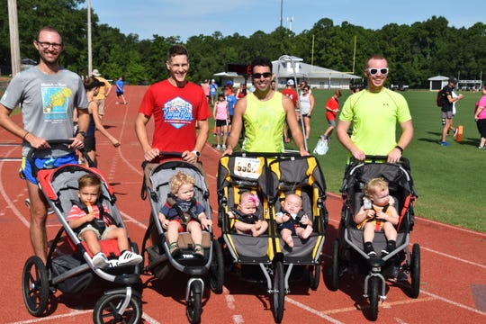 "The ""Baby Daddies"" Stroller Relay Team. Left to right – Zach Deveau and Barret Deveau; Zack Scharlepp, Reis Scharlepp;   Eric Godin – Aryana and Chase - Godin; Cory Wilson – Piney Leona Wilson"
