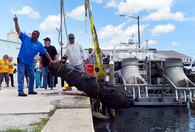 A work crew from the City of Fort Pierce along with members of Maritime Research and Recovery hoist a cannon from the 1715 Spanish Plate Fleet out of the water at Fisherman's Wharf on Monday, Aug. 13, 2018, in Fort Pierce. The recovery of the cannon, discovered in the remains of a shipwreck off Sandy Point, is a collaboration between the Keep Fort Pierce Beautiful Advisory Board and the Fort Pierce Lions Club. The restoration of the cannon will take about three years and will be put on display in the plaza at Melody Lane Fishing Pier.