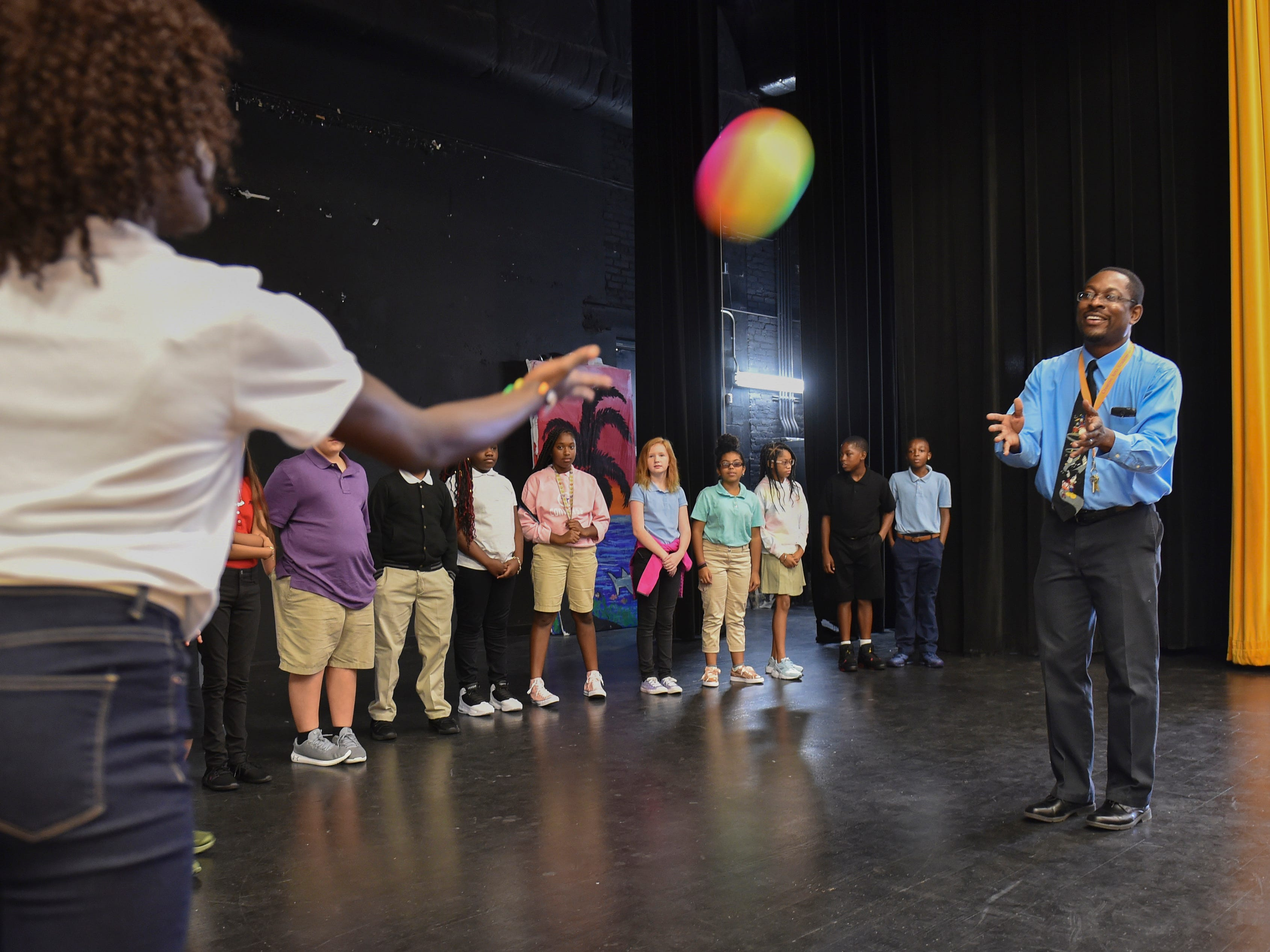 """Wallace Rahming (right), musical theater teacher at the new Creative Arts Academy of St. Lucie, interacts with some theatre games to break the ice with his sixth-grade students on the first day of school on Monday, August 13, 2018 in Fort Pierce. """"It's homecoming for me. I taught in this county for eleven years, left for sixteen, and coming back, it's going to be exciting,"""" Rahming said. """"We're doing some great things here especially with the arts. We've never done it in St. Lucie County before, so I'm really excited about the opportunity."""""""