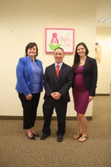 Valerie Bell, left, vice president of Martin County Healthy Start Coalition Board of Directors; Jason Berger, president of Healthy Start Coalition Board of Directors, and Samantha Suffich, executive director of Martin County Healthy Start Coalition.
