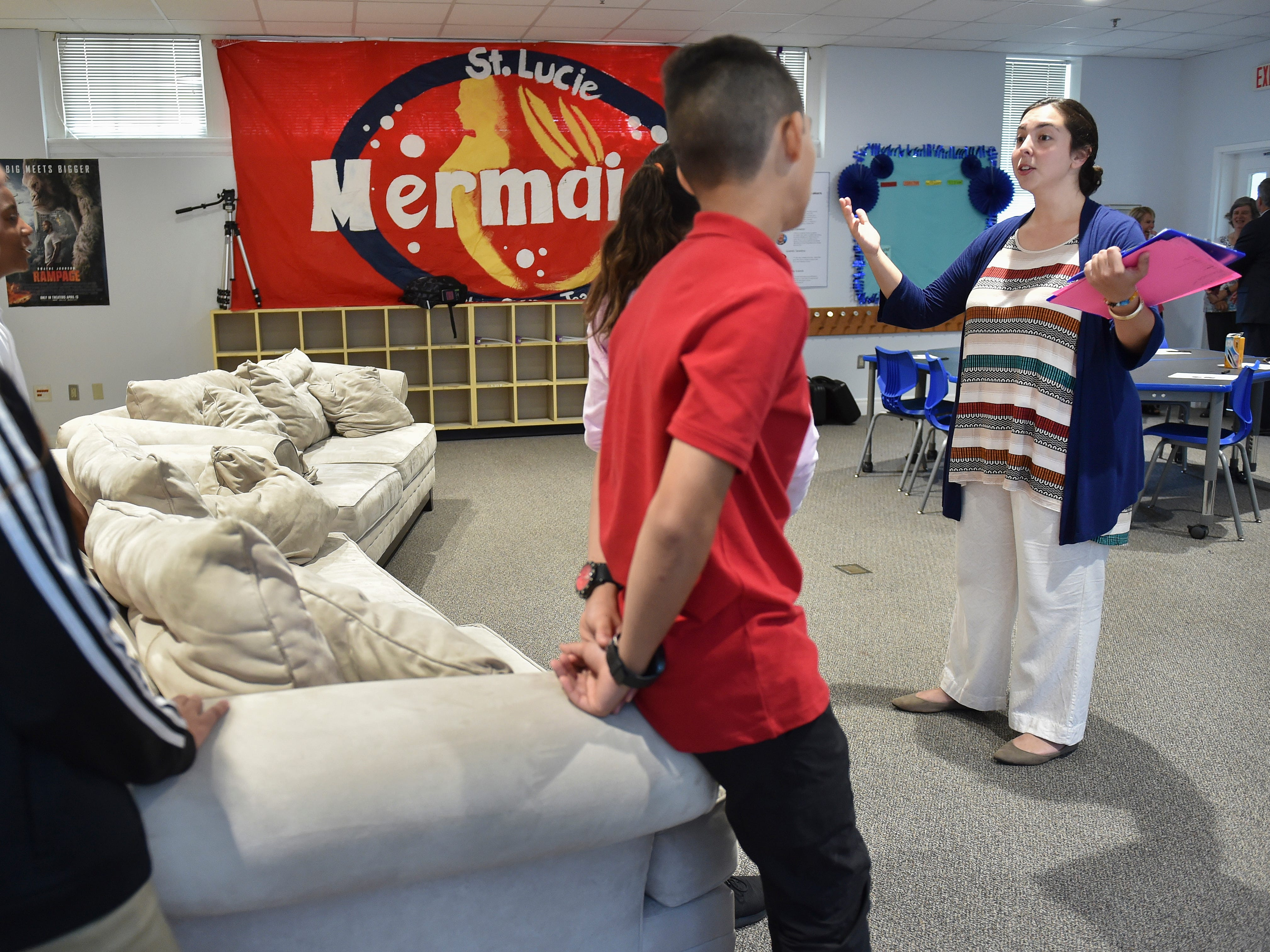 """Shaina Feldman, media arts teacher at the new Creative Arts Academy of St. Lucie, talks with her middle school students, introducing them to her class on the first day of school on Monday, August 13, 2018 in Fort Pierce. """"I'm so lucky to be a part of this. What a great opportunity to be a part of creative arts in my hometown, it's a dream,"""" Feldman said. """"Film is the language of the modern world so I'm teaching kids how to navigate and become critical thinkers in all of the media they consume today, and they will leave my class creating."""""""