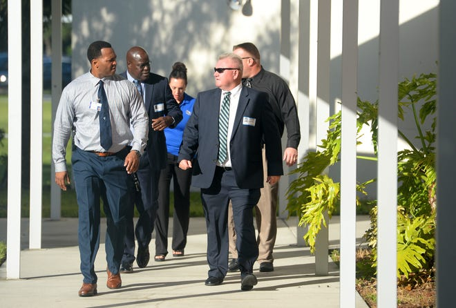 """Sebastian River High School principal Dariyall Brown (left) leads a campus tour for Damien Kelly (right), the director of the newly created Office of Safe Schools, on the first day of school Monday, Aug. 13, 2018, in Indian River County. """"I think it's important to see what these campuses look like, they're all vastly different, so I want to see what's out there and what we need to do moving forward,"""" Kelly said. """"It's the society we live in today, the tragedy that happened in Parkland was a wakeup call for everybody, but I've been really impressed with everywhere I've been. No one has been sitting back waiting for school to open to see how they were going to tackle security measures."""" Kelly has 25 years of experience in law enforcement, most recently as a special agent with the Florida Department of Law Enforcement."""