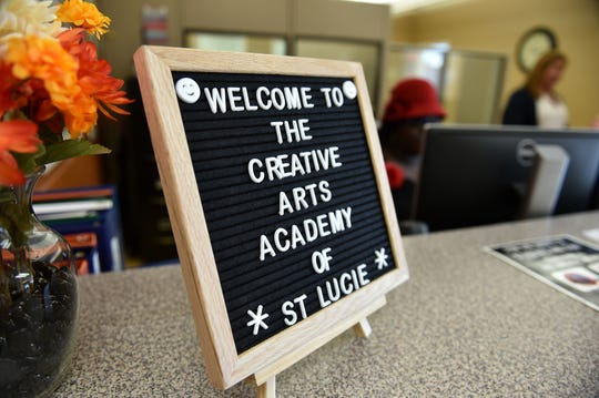 "A sign welcomes students to the first day of school, Monday, August 13, 2018, at Creative Arts Academy of St. Lucie, a new K-8 school in Fort Pierce, part of St. Lucie Public Schools in St. Lucie County. ""The first day is always an exciting day, the kids are excited to come back, their teachers are all excited, and we're just looking forward to another great year,"" said School Superintendent Wayne Gent."