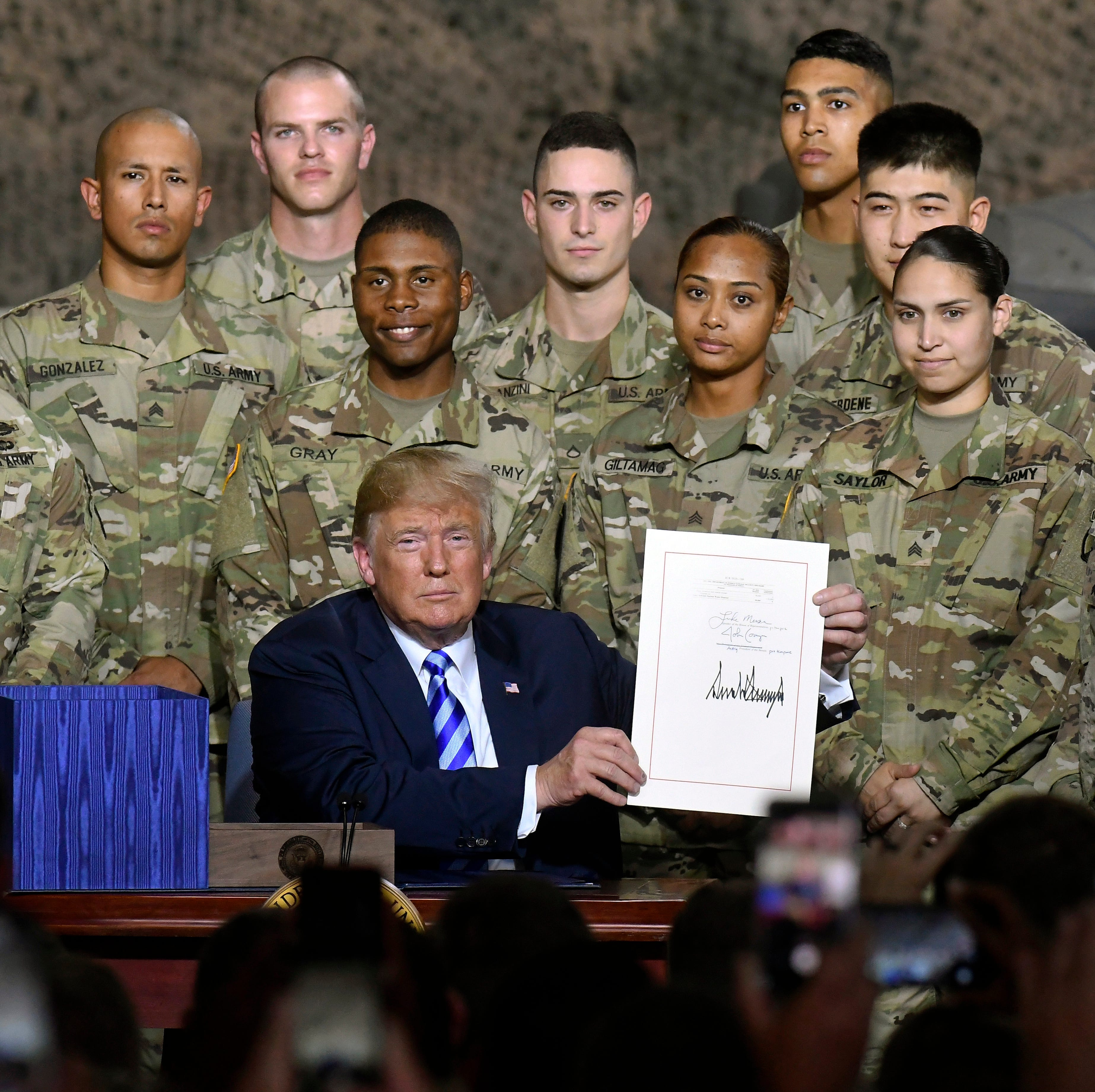Trump signs McCain defense bill in Fort Drum, NY