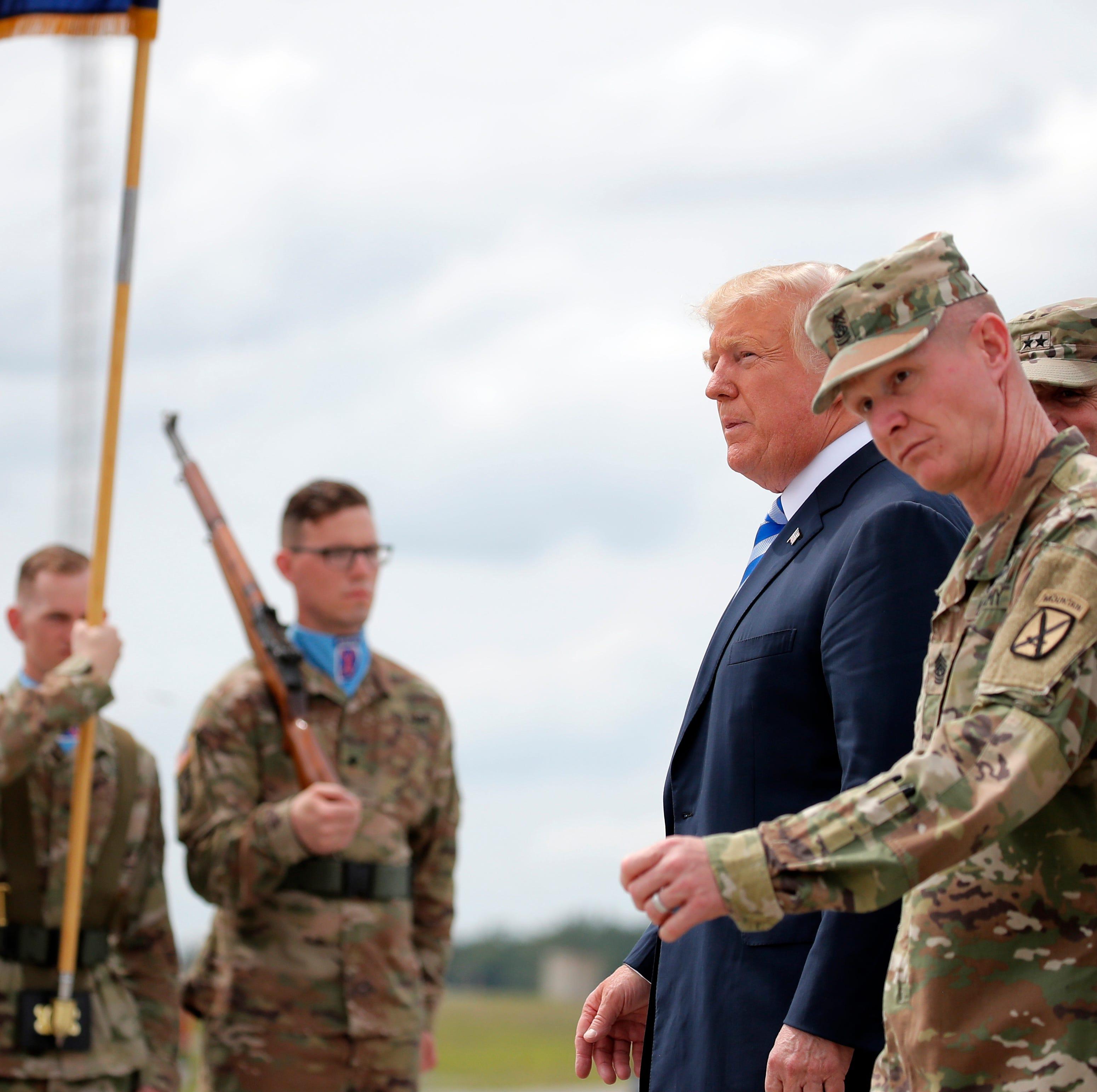 Trump signs McCain defense bill that boosts military pay; no mention of senator