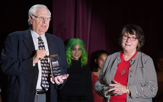 Dennis Gilmore presented Gai Jones with the Distinguished Merit Award from the American Association of Community Theatre.
