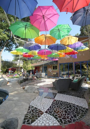 A canopy of umbrellas provides shade for guests at local artist Darlene Graeser's Brillig Manor in Thousand Oaks. California Museum of Art Thousand Oaks arranged tours of the unique home on Sunday.