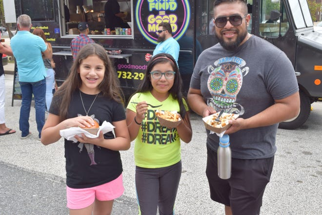Dennis, Lexi and Isa Perez, all of Vineland, enjoyed lunch from Good Mood Food during last year's Vineland's Food Truck Festival on The Ave. This year's event will be held from 11 a.m. to 7 p.m. Aug. 26, rain or shine, at Landis Avenue and the Boulevard.