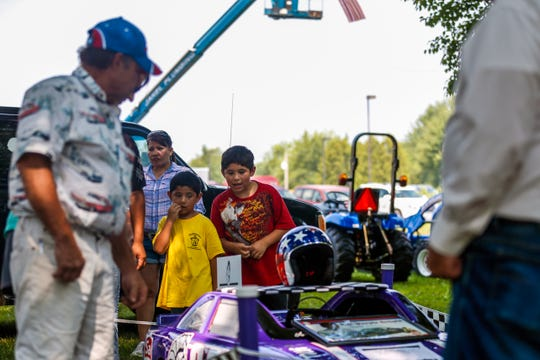 Kids look at a car on display during the Abbotsford First City Days festival in Abbotsford, Wis., August 12, 2018.