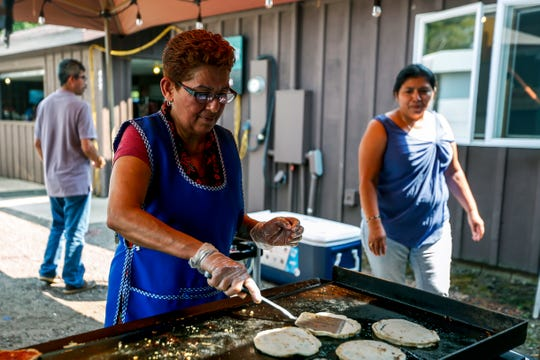 Members of a local church group cook picadas and tamales to sell at the Abbotsford First City Days festival in Abbotsford, Wis., August 12, 2018.