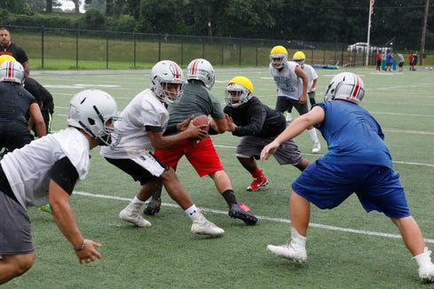 Members of the Yonkers Brave high school football team practice drills at Saunders High School in Yonkers on Aug. 13, 2018.
